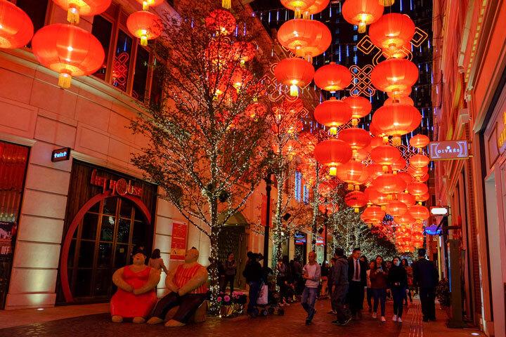 Red Chinese New Year's lanterns hanging along a Hong Kong street