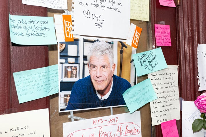Flowers and photos placed in honor of Anthony Bourdain