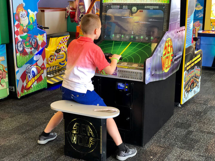 Boy plays an arcade game