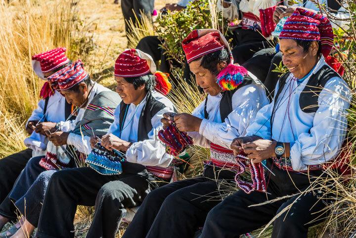 A group of Peruvian men knitting
